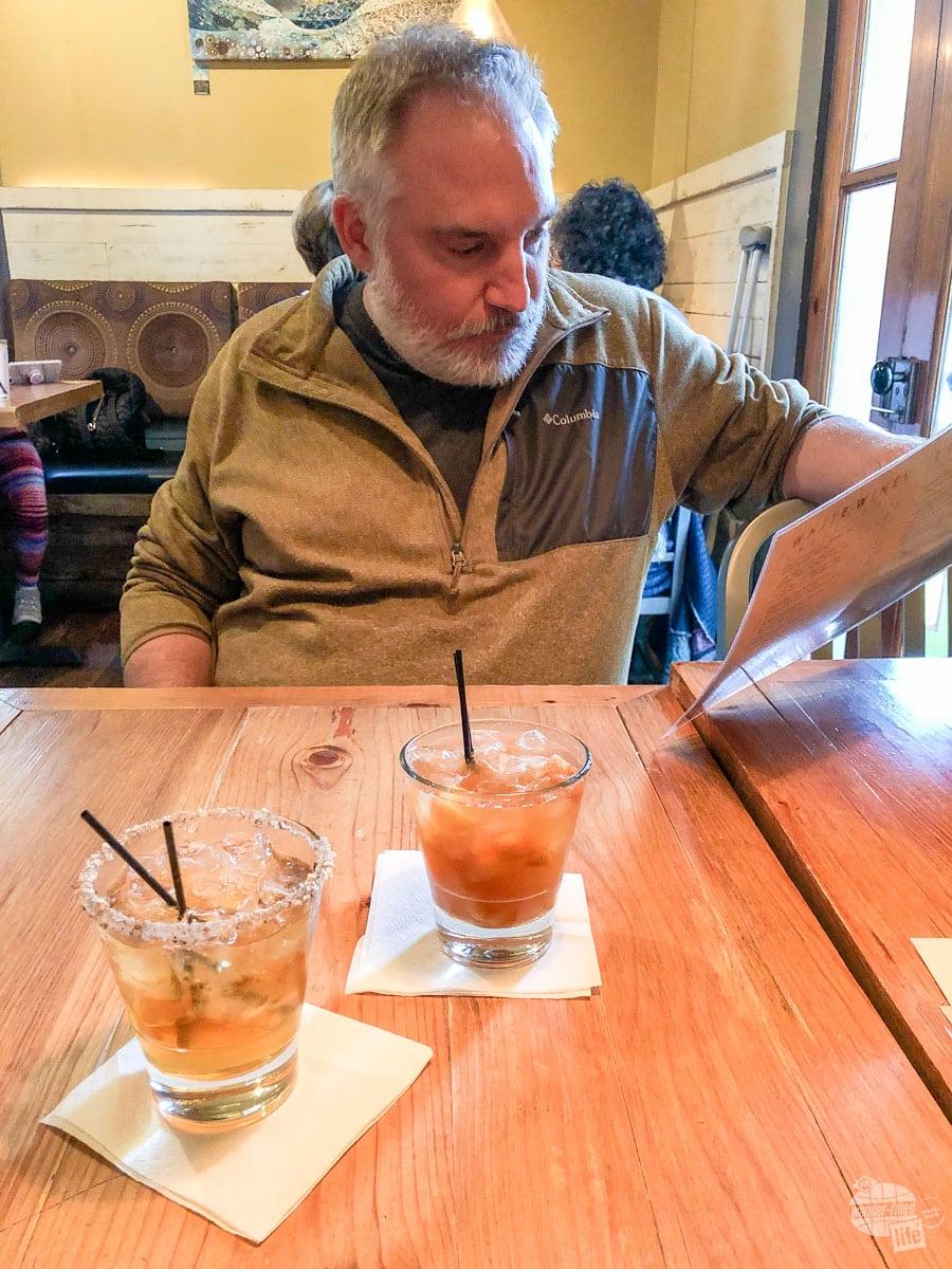 Grant perusing the menu at Century House Tavern.