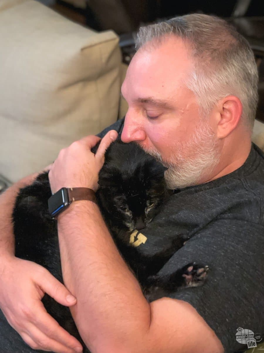 Grant snuggles with Alee after the visit to the vet.