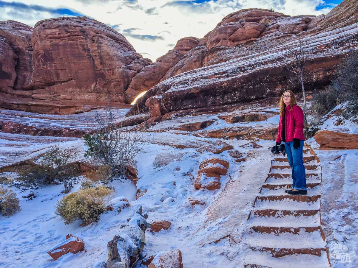 Bonnie hiking up to Delicate Arch.