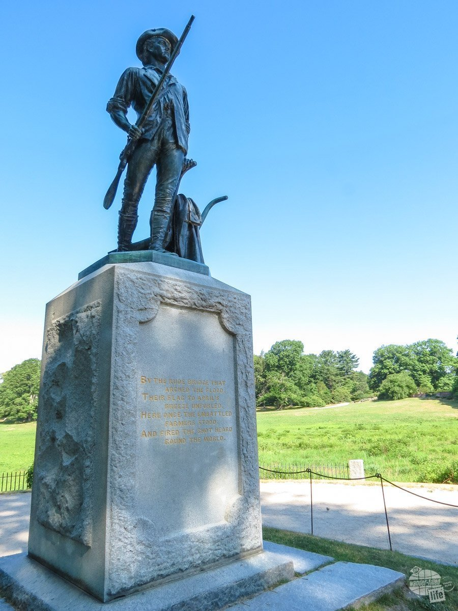 """The minuteman memorial stands a few feet from the North Bridge, where """"the shot heard 'round the world"""" was fired in Concord."""