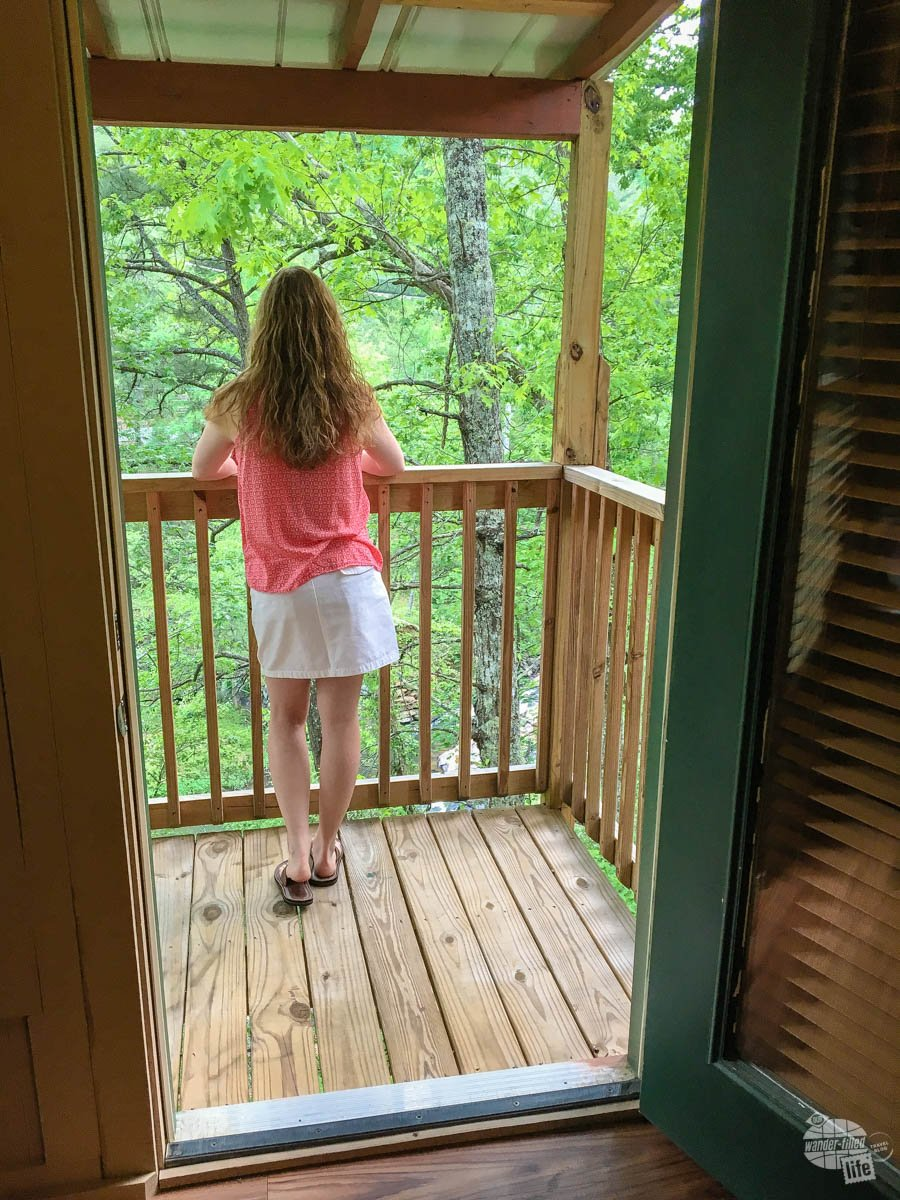 Bonnie enjoying the view from the deck of the treehouse.