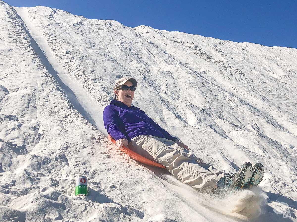 Bonnie sliding down the dune.
