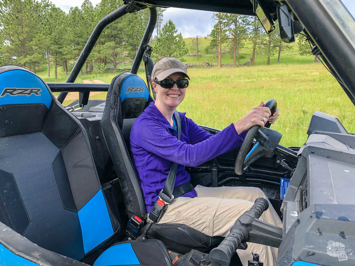 Bonnie driving an ATV in the Black Hills.