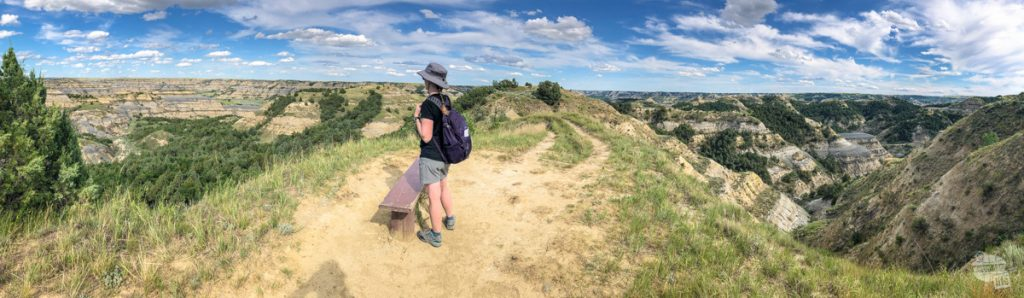 Bonnie admiring the view on the knife edge ridge on the Caprock Coulee Trail.